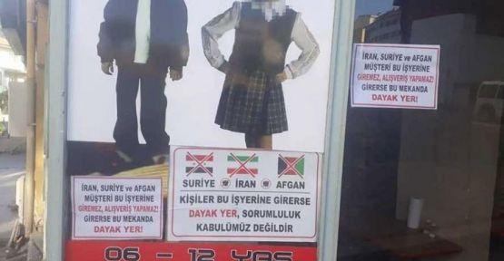 Irkçı afiş asan esnafa 'uyarı' cezası