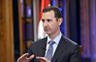 Suriye Devlet Başkanı Esad başbakanı görevden...